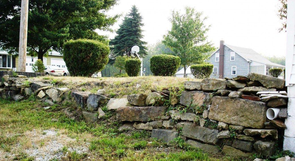 failed stone retaining wall